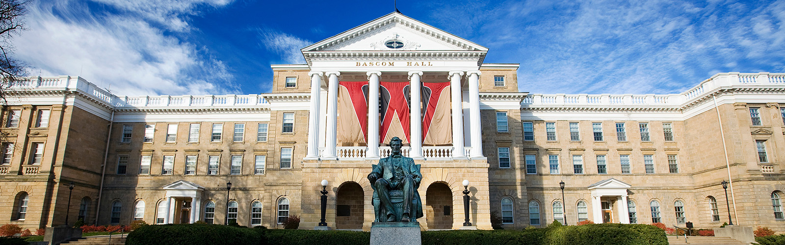 "An iconic ""W"" banner hangs between the columns of Bascom Hall at the University of Wisconsin-Madison on Nov. 10, 2007."