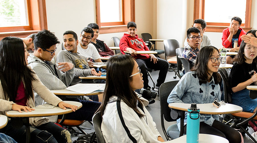 A group of 25 first-year international students list to Gail Ibele, associate director of the English as a Second Language (ESL) program, talks during an International Student Summer Institute class session at the University of Wisconsin-Madison on Aug. 4, 2017. The new program lets first-year international students arrive several weeks ahead of the fall semester and take an academic reading and writing class for non-native English speakers. The students also participate in a wide array of campus and community activities and meet current domestic and international students, all with the goal of helping them acclimate to U.S. life.